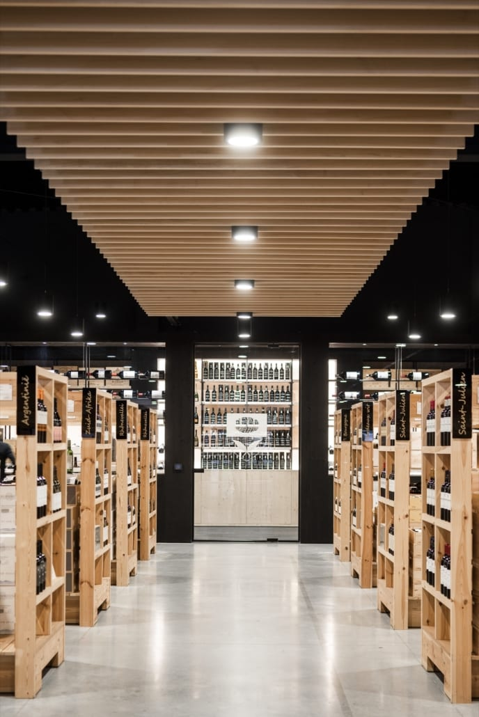 Acoustic baffles finished with oak veneer for a liquor store