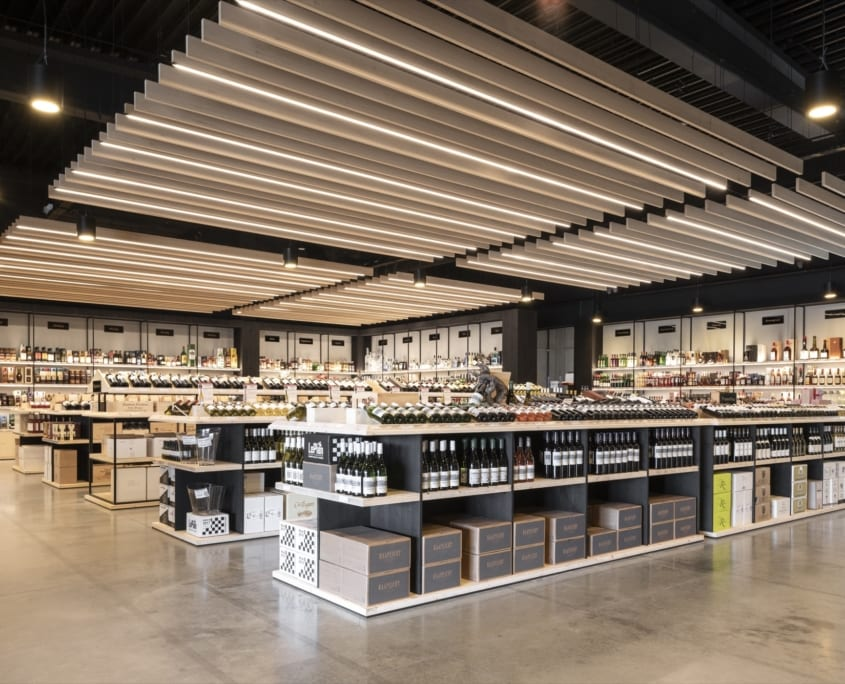 Side view of acoustic baffles in a beverage store