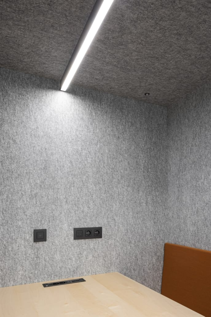 Acoustic silver wall and ceiling cladding with lighting