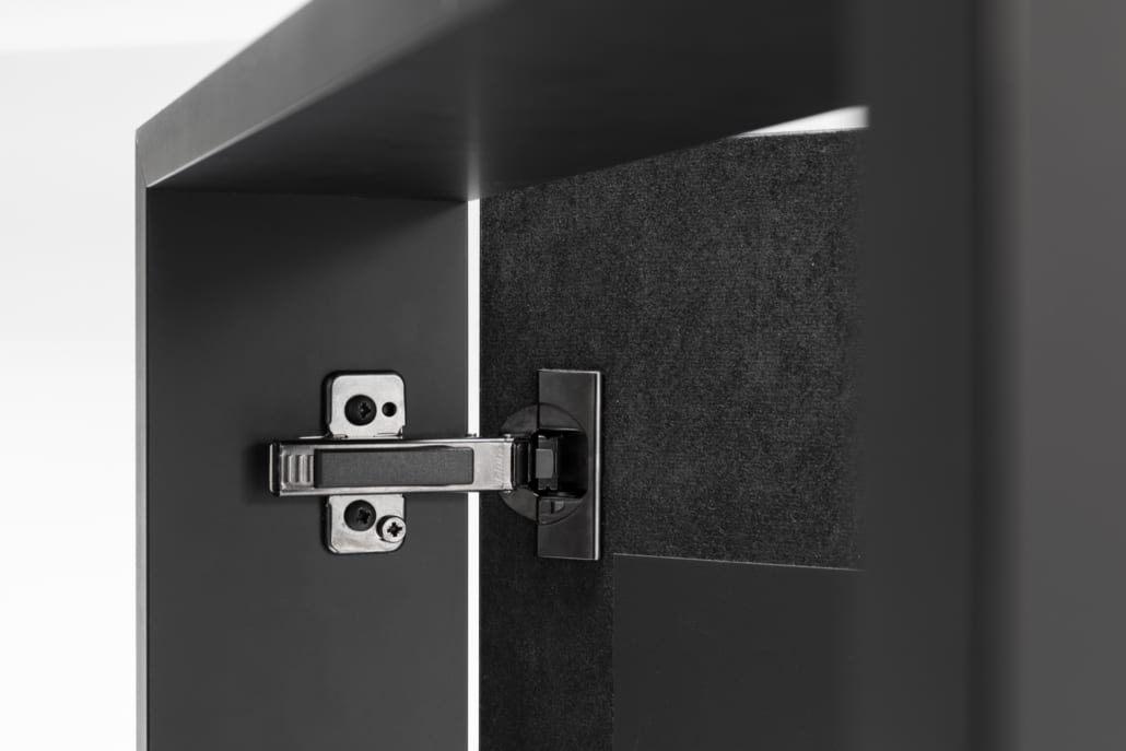 Detail hinge cabinet with cabinet covering in acoustic material